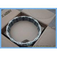 China Heavy Duty Galvanized Barbed Concertina Barbed Tape Razor Wire on sale
