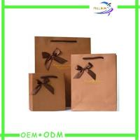 China Customize Natural Kraft Paper Bags With Bow , Retail Paper Shopping Bags on sale