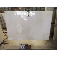 Buy cheap 15mm Thickness Snow White Onyx Marble With Red Veins product